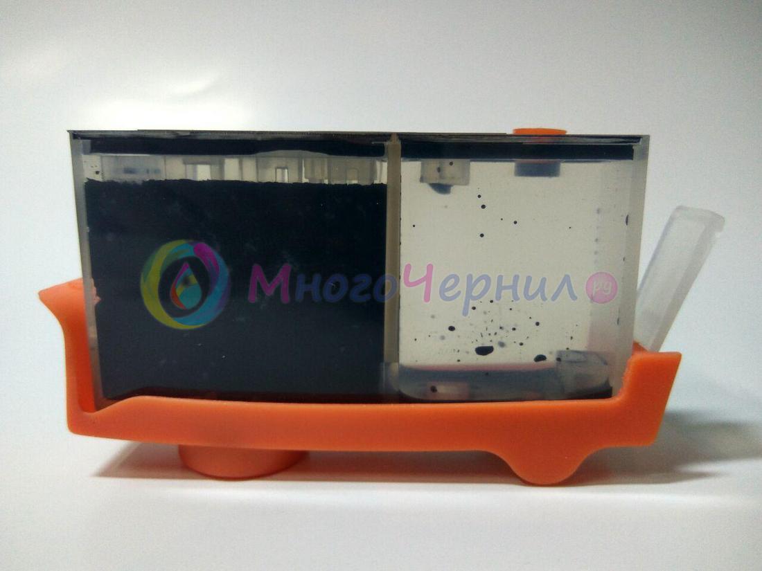 Грязный картридж, установленный на оранжевую подставку